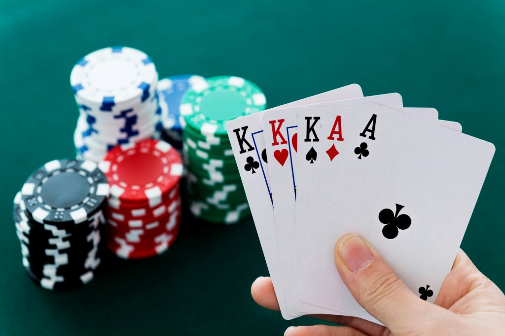 Woman hand holding aces and king cards